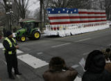 JOE0214  Police stop traffic and pedestrians to allow a float to move down Constitution Avenue...