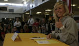 JOE029 Arapahoe High School soccer player Amy Barczuk flashes a thumbs up after she signed her...