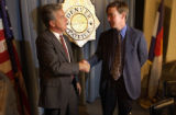 City of Denver District Attorney, Mitch Morrissey (left), is congratulated on a job well done by...