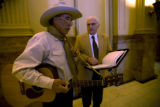 Rep. Wes McKinley (D- Wash)takes a break from singing and playing to do a little leg business with...
