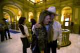 Rep. Wes McKinley (D- Wash)gives a hug to Jayne Ford - whose family has a ranch in McKinley's...