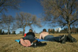 FOR WEB Scott Allen and Rainey Schuyler enjoy the warm weather at Cheeseman Park on Wednesday,...