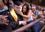 Matt Jones (cq left), a 21-year-old Monarch High student with Down's syndrome, sits with Andrea...