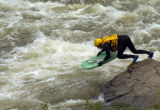 A diver from West Metro Search and Rescue dives into Clear Creek in Golden Sunday afternoon June...