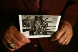 89-year-old Sam Hunter (cq) shows a photograph of his squadron (from left) pilot Rayner Amhad...