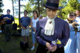 Johanna Harden (cq), front, says a prayer during the burial of a body of an unnamed pioneer women...