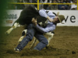 At the National Western Stock Show Hunter Cure takes down his steer in steer wrestling  at the...