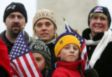 (0810) (front three from left) Ali Hurley, 8, mom Kelley Hurley, and Patrick Hurley, of Boston,...