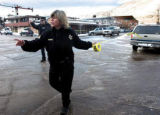 Aspen police officer Gretchen Born directs pedestrians away from Wells Fargo Bank (behind her),...