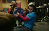 Marshall Dunrud, 16 mon. gets hip hop lessons from Erin Wilson at the Children's Museum, Denver,...