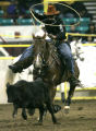Justin Richard competes in the steer roping event at the MLK Jr.  African American Rodeo at the...