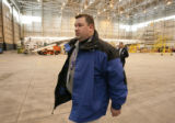 Jeff Green PIO for Continental walks through the shared Continental hangar in Commerce City, Colo,...