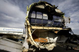 A view of the front section of the wreckage of Continental Flight 1404 is placed in an enclosed...