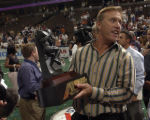 Colorado Crush team owner, John Elway, holds the 2005 Arena Football League division championship...