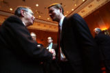 (0018) Newly-appointed Colorado Senator Michael Bennet shakes hands with Dr. Fredrick Grover at a...