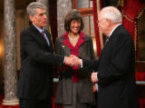 (0294) Newly-elected Colorado Senator Mark Udall shakes hands with Vice-President Dick Cheney at a...
