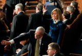 (0530) Newly-elected Colorado Rep. Betsy Markey waves to supporters before being sworn in at the...