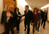(0942) Newly-elected Colorado Senator Mark Udall shakes hands with supporters at the Capitol in...