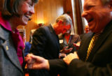(1067) Newly-elected Colorado Senator Mark Udall, center, talks with a supporter as his wife...
