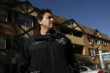 DM0552  Denver Fire's Lt. Phil Champagne talks to reporters outside the Josephine Place Apartments...