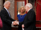 (0788) Vice-President elect Joe Biden shakes hands with Vice-President Dick Cheney at the Capitol...