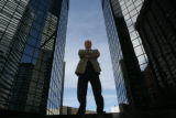 Richard Fulkerson (cq), former Colorado bank commissioner for 12 years stands in between the World...