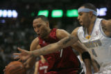 #4 Kenyon Martin (cq) of the Denver Nuggets reaches into #7 Shawn Marion (cq) of the Miami Heat...