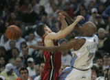 #7 Chauncey Billups (cq) of the Denver Nuggets fights for a steal from #11 Chris Quinn (cq)  of...