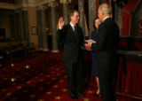 MJM1954 Vice President Joe Biden (cq), right, does a reenactment swearing in of Sen. Michael...
