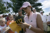 Michelle Wie signs autographs on the first hole of the Cherry Hills Country Club during a practice...