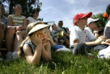 Sydney Randall, 7, cq, of Yoder, Colo. watches intently as golf performer Dennis Walters executes...