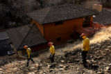 MJM335  Firefighters look for hot spots behind the Knutson's Lee Hill Rd. home after the Olde...