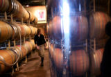(PG11550) Winemaker Michelle Cleveland works on red and white wines at Creekside Cellars in...