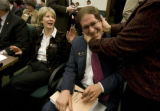 Rep. Mark Ferrandino (D-Denver) gets a playful embrace from Rep. Nancy Todd (D-Aurora) with...
