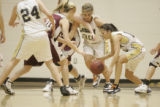 Girls of Legacy fight for the ball with girls from Horizon basketball team during the first half...