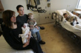 (0043) Mother Sarah Moser holds her newborn daughter Eve Maria Moser, the first Colorado baby of...