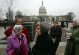 (0444)  Marie Bel Castro, center, stands infront of the Capitol along with a group from Ohio in...