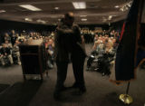 Michael Bennet and Gov. Ritter hug each other during a commuity forum at the Loveland Museum, in...