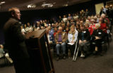 Michael Bennet addresses a packed auditorium during a commuity forum at the Loveland Museum, in...