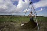 Kansas Anthropological Association volunteer Roger Ward (cq) of Eldorado, Ks. sifts through some...