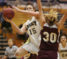 #15 Carli Moreland (cq) of Legacy drives against #30 Kelsey Foster (cq) of Horizon during the...