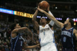J.R. Smith (cq) of the Denver Nuggets drives into Deron Williams (cq)  of the Utah Jazz during the...