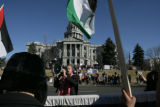 Hasan Ayoub (cq) of Denver repeats chants during a rally in support of Palestinian people of Gaza...