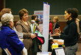 (0014) Christin Kalaskie, Director of Development at Wealth Concepts, right, talks with a group of...