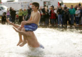 (0581) Dave Lawson and his son Jake Lawson, 10, jump into Boulder Reservoir for the Polar Plunge...
