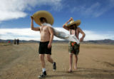 (0792) Kirk Coppes, left, and Justin Kettler, right, walk to the beach before the Polar Plunge at...