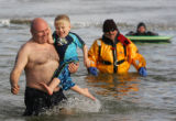 (0399) Craig Parsons and his son Jac Parsons (cq), jump into the Boulder Reservoir for the Polar...