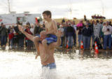 (0579) Dave Lawson and his son Jake Lawson, 10, jump into Boulder Reservoir for the Polar Plunge...
