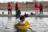 (0711) Jesse Gettert wades into the water with an inflatable duckie at the Polar Plunge at the...