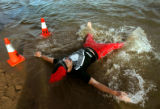 (1041) Ryan Van Duzer lies in the water at Boulder Reservoir for the Polar Plunge in Boulder,...